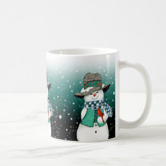 Muñeco de nieve sonriente, cardinal en una taza de