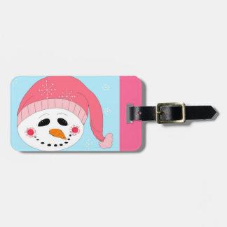 Muñeco de nieve sonriente en un gorra rosado etiquetas para maletas