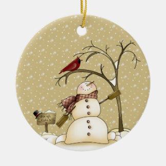 Muñeco de nieve y pájaro rojo de nuestra casa el s ornamento para arbol de navidad