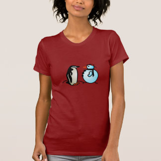 muñeco de nieve y pingüino camisetas