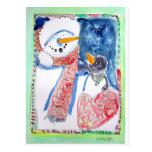 Muñeco de nieve y pingüino tarjeta postal