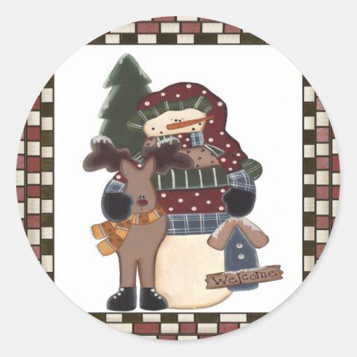 Muñeco de nieve y reno agradables etiqueta redonda