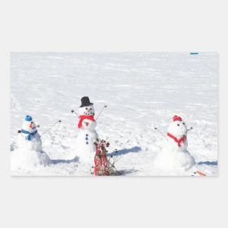 Muñecos de nieve del navidad rectangular pegatina