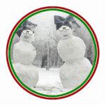 Muñecos de nieve grandes del gorra del arco esculturas fotográficas