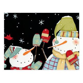 Muñecos de nieve modernos con las manoplas postales