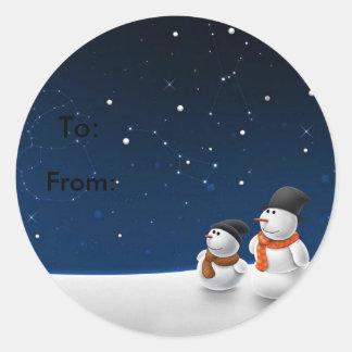 Muñecos de nieve padre e hijo pegatina redonda
