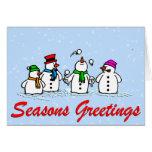 Muñecos de nieve que hacen juegos malabares tarjeta de felicitación