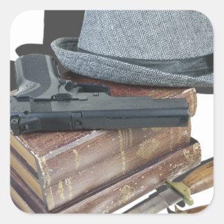 MurderMysteryBooksGunKnivesFedora042113.png Square Sticker