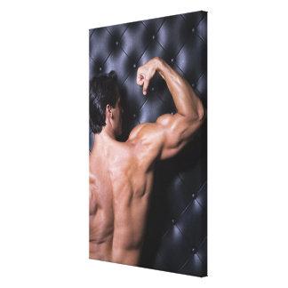Muscular man flexing canvas print