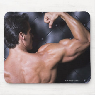 Muscular man flexing mouse pad