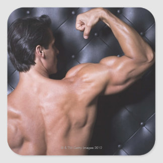 Muscular man flexing square sticker