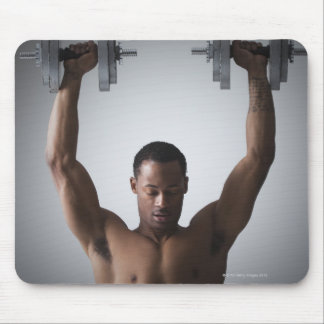 Muscular man lifting dumbbells 2 mouse pad