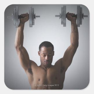 Muscular man lifting dumbbells 2 square sticker