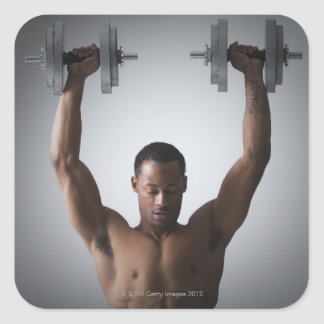 Muscular man lifting dumbbells 2 stickers