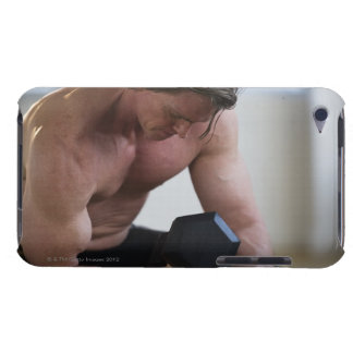 Muscular man lifting free weight barely there iPod cases