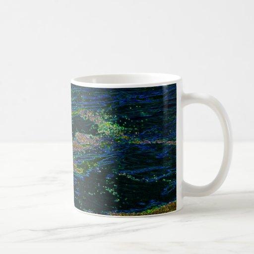 Musgo encendido en el agua tazas de café