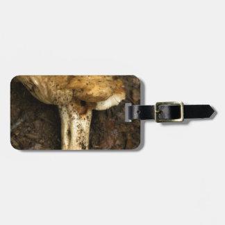 mushroom in the dirty mud luggage tag