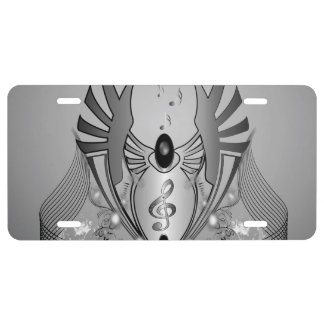 Music, clef in black and white on a shield license plate