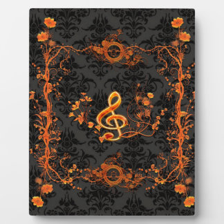 Music, decorative clef with flowers plaque