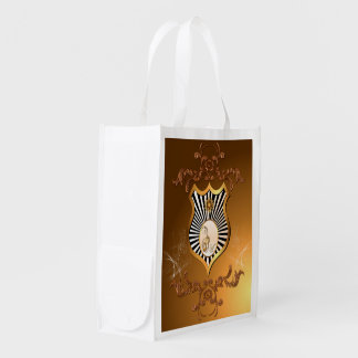Music, golden key notes on a shield reusable grocery bag