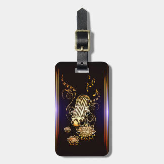 Music, golden microphone tag for luggage