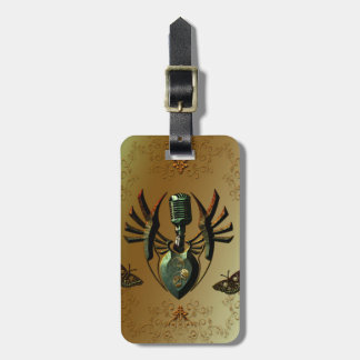 Music, microphone on green shield travel bag tag