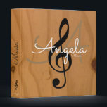"""music monogram on image of wood, my songs binder<br><div class=""""desc"""">Wood texture background with a monogram and a graphic musical note (black-treble-clef)...  nice idea for your favorite songs,  music-idols,  music lessons... </div>"""