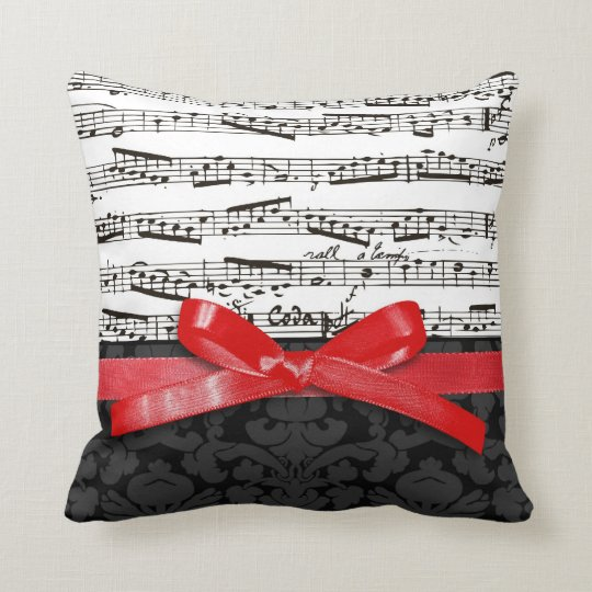 Music notes and faux red ribbon throw pillow