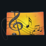 """Music Notes Bagettes Bag<br><div class=""""desc"""">Colorful three dimensional music design with notes in black and gold on a bright orange and red gradient background. Trebles,  flats,  sharps,  quarter,  eighths and sixteenth notes on a curved staff portray a contemporary look for the modern musician.</div>"""