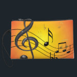"Music Notes Bagettes Bag<br><div class=""desc"">Colorful three dimensional music design with notes in black and gold on a bright orange and red gradient background. Trebles,  flats,  sharps,  quarter,  eighths and sixteenth notes on a curved staff portray a contemporary look for the modern musician.</div>"