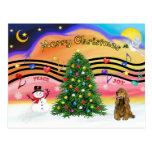 Música 2 del navidad - cocker spaniel (marrón) postal