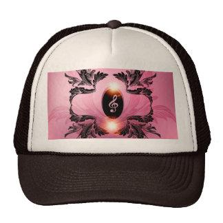 Música, clef en fondo rosado gorras