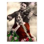 Música del violín jugada por el músico del vintage postales