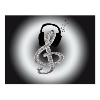 Música Gclef con las auriculares Postales