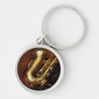 Música - latón - saxofón llavero redondo plateado