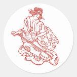 Música que juega virginal del geisha etiqueta redonda