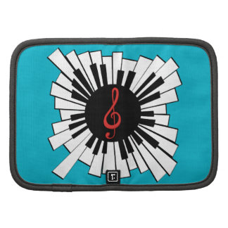 Música y amantes teclado y clef radiales del piano planificador