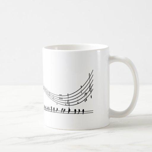 Música y mirlos del saxofón del ~ del saxofón taza