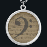 """Musical Bass Clef sheet music Silver Plated Necklace<br><div class=""""desc"""">The bass clef is the perfect gift for people who love music - music teachers, vocalists, performers, orchestra and band members, and music lovers. The beautiful bass is on a backdrop of antique sheet music. The bass is a bold musical statement that features the perfect musical background for musicians and...</div>"""