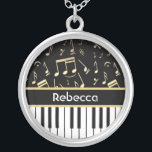 """Musical Notes and Piano Keys Black and Gold Silver Plated Necklace<br><div class=""""desc"""">An elegant design for the pianist or keyboard player - featuring keyboard keys with golden colored musical notes on a black background. The background color can be changed to any color to suit your own needs and style, Customize the text on the golden colored strip between the piano keys and...</div>"""