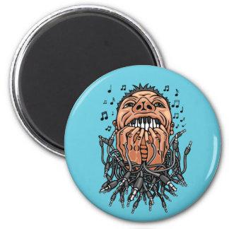musician plays on his teeth like on keyboard magnet