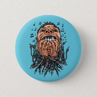 musician plays on his teeth like on keyboard pinback button