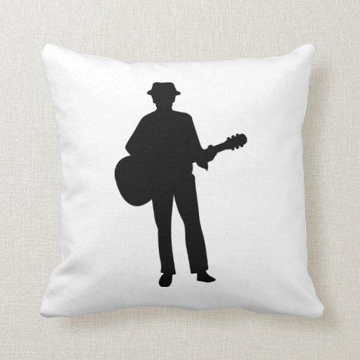 Músico de la guitarra almohada