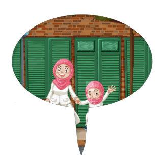Muslim girls on the sidewalk cake topper