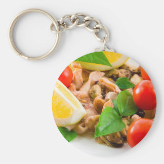 Mussels, squid and octopus, decorated with greens, keychain