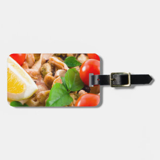 Mussels, squid and octopus, decorated with greens, luggage tag