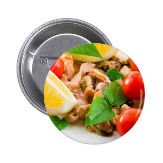 Mussels, squid and octopus, decorated with greens, pinback button