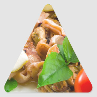 Mussels, squid and octopus, decorated with greens, triangle sticker