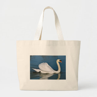 Mute swan on water canvas bag