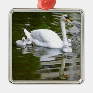 Mute swan with nestlings on water metal ornament